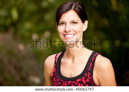 A happy fitness woman in the park - lifestyle portrait - stock photo