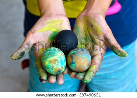 A happy girl with painting Easter eggs decorate by herself  - stock photo