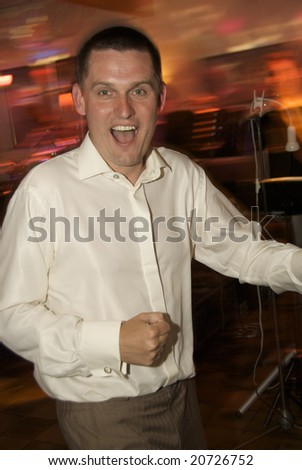 a happy groom dancing at the wedding party