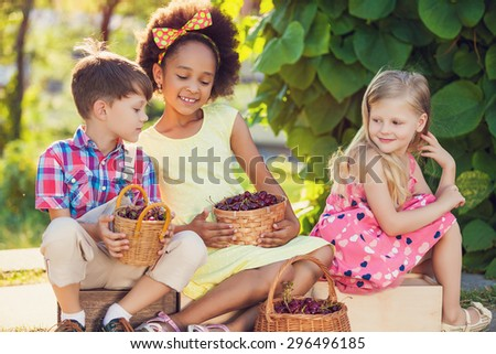 A happy group of Multi-ethnic children sitting happily