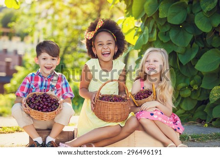 A happy group of Multi-ethnic children sitting happily - stock photo