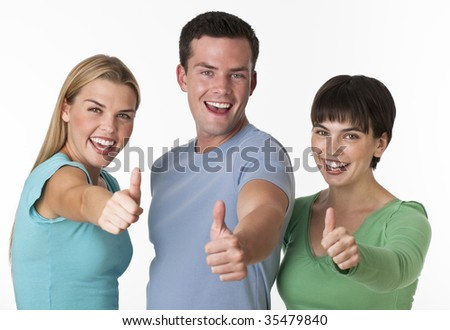 A happy group of two females and a male posing with their thumbs up.  They are smiling directly at the camera.  Horizontally framed shot.