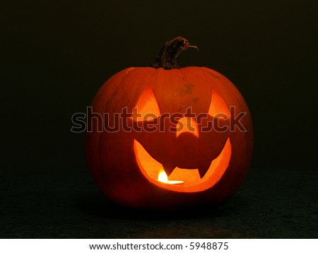 A happy halloween pumpkin lantern with candle - stock photo