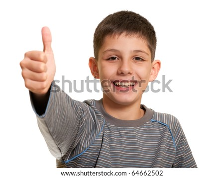 A happy handsome kid is holding his thumb up; isolated on the white background