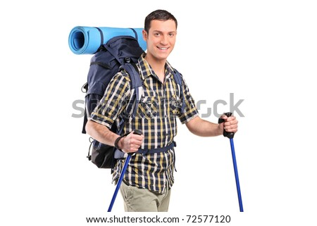 A happy hiker with hiking poles and backpack posing isolated on white background - stock photo