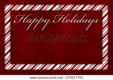 A Happy Holidays card, A Candy Cane border with words Happy Holidays over red plush background with copy-space - stock photo