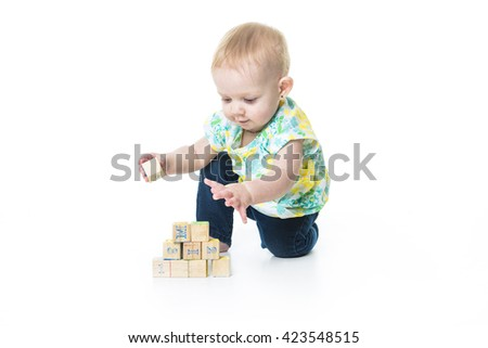 A Happy kid playing toy blocks  isolated on white background - stock photo
