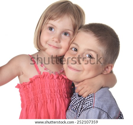 A Happy kids relaxing laying on white - stock photo