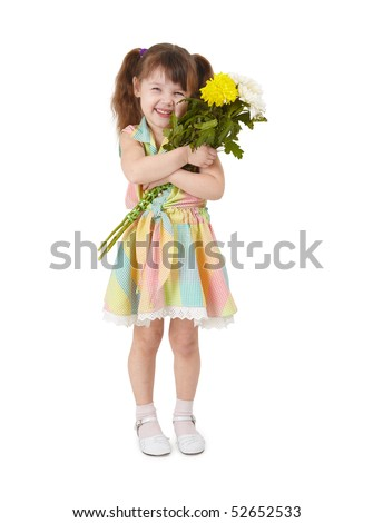 A happy little girl with a bouquet of flowers in hands - stock photo