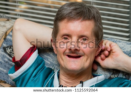 stock-photo-a-happy-man-with-down-syndro