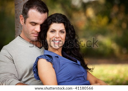 A happy married couple relaxing in the park - stock photo