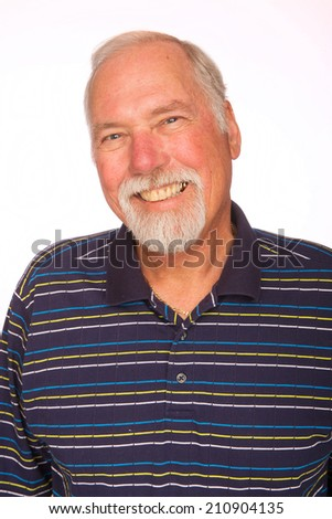 A happy mature man with white hair and a beard - stock photo