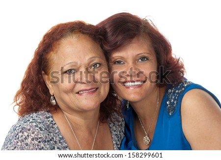 A happy mother and daughter embrace each other. - stock photo