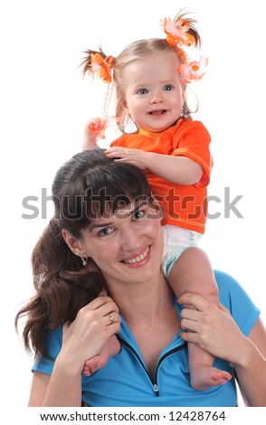 A happy mother holds a baby.