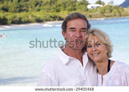 a happy older couple enjoys retirement in the tropics - stock photo