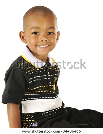 A happy portrait of a handsome American American preschooler.  Isolated on white. - stock photo