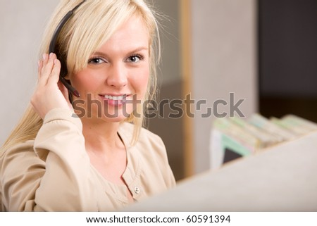 A happy receptionist with a phone headset - stock photo