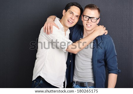 A happy same-sex couple hanging out - stock photo
