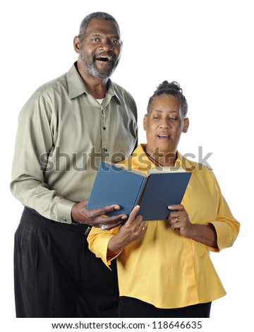 A happy senior African American couple sing a duet from the same book.  On a white background. - stock photo