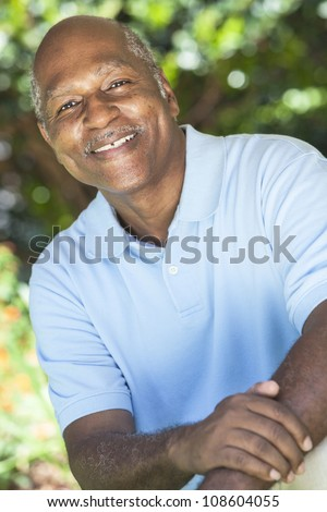 A happy senior African American man in his sixties outside smiling. - stock photo