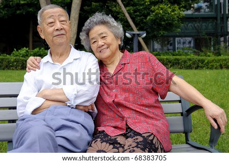 a happy senior couple embraced - stock photo