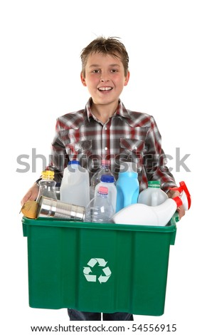 A happy smiling boy carrying a container bin of cans and bottles suitable for recycling.  White background. - stock photo