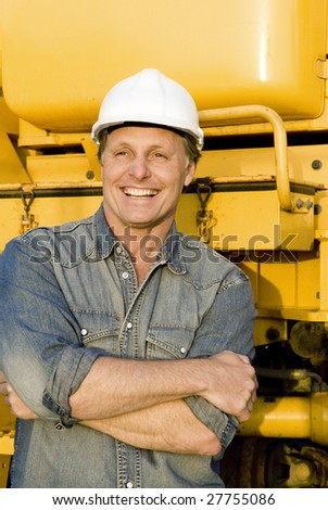 A happy smiling builder. - stock photo