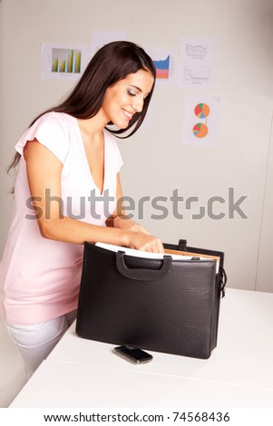 A happy smiling business woman presents some documents - stock photo