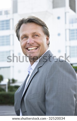 A happy smiling businessman. - stock photo