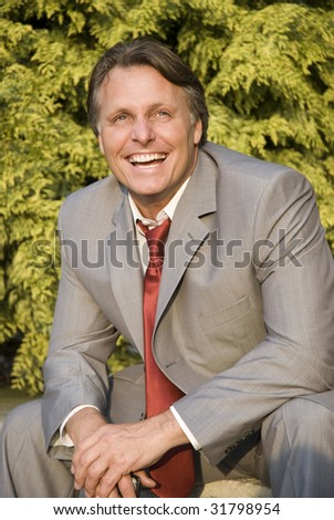 A happy smiling businessman looking up. - stock photo