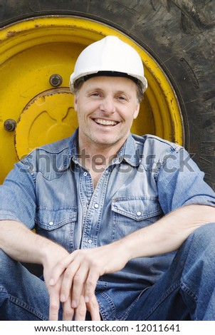 A happy smiling contruction worker. - stock photo