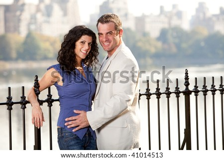 A happy smiling couple in the park - stock photo