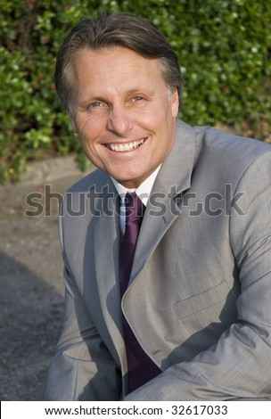 A happy smiling forties businessman. - stock photo