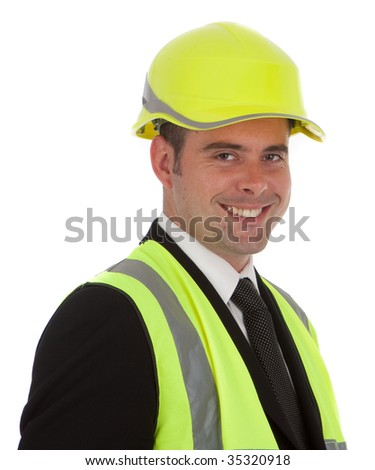 A happy smiling successful architect or engineer wearing the latest in high visibility safety equipment