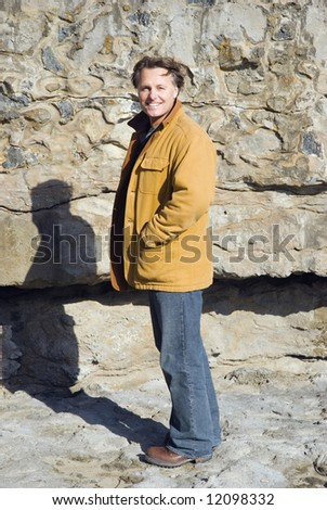 A happy smiling 43 year old man. - stock photo