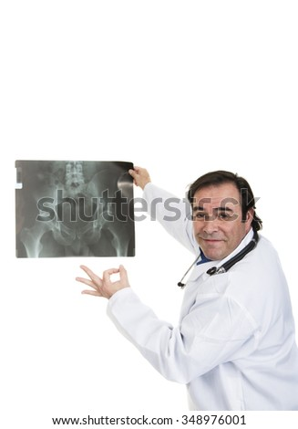A happy specialist physician holding x ray - stock photo