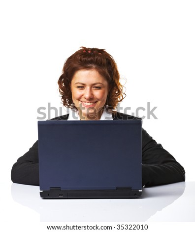 A Happy successful business woman smiling while working on laptop