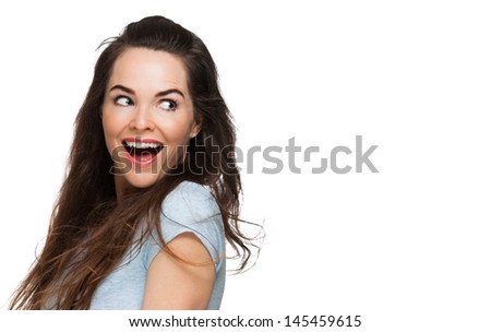 A happy surprised woman looking over her shoulder at copy-space. Isolated on white. - stock photo