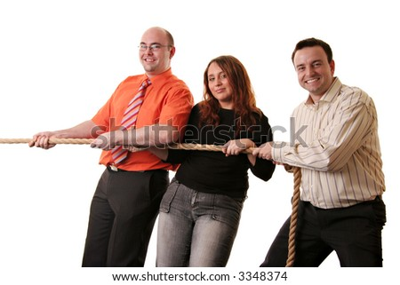 A happy team of three in a tug of war isolated against a white background - stock photo