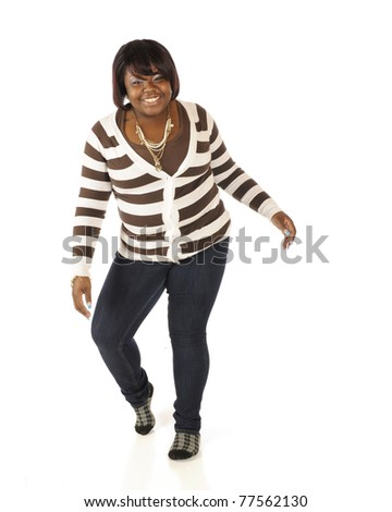 A happy teen girl in broad stripes attempting to do the Moon Walk.  Isolated on white. - stock photo