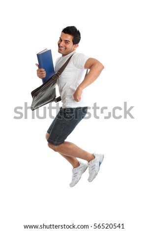 A happy thrilled excited university or college student jumping into the air.  Some motion in legs.  White background. - stock photo