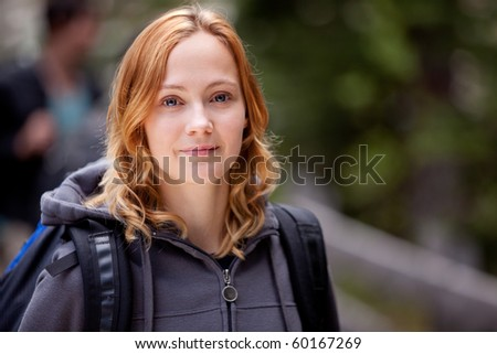 A happy woman camper on a hike in the forest - stock photo