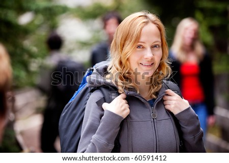 A happy woman camper outdoors in the forest - stock photo