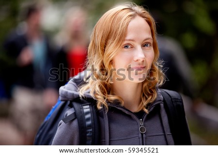 A happy woman outdoors on a hiking trip - stock photo