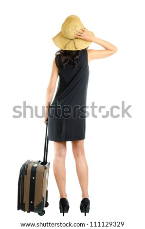 a happy woman traveling with hat and bag - stock photo