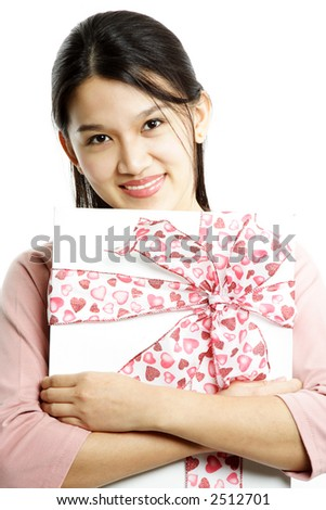 A happy woman with gift box with pink ribbon