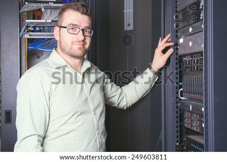 A happy worker technician at work with computer