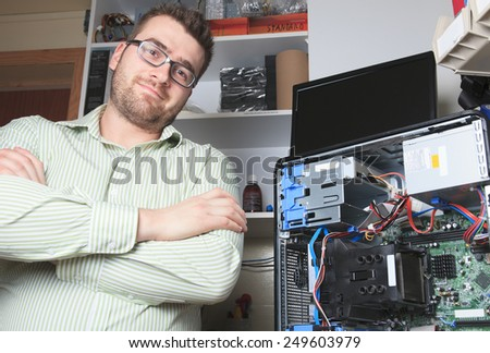 A happy worker technician at work with computer - stock photo