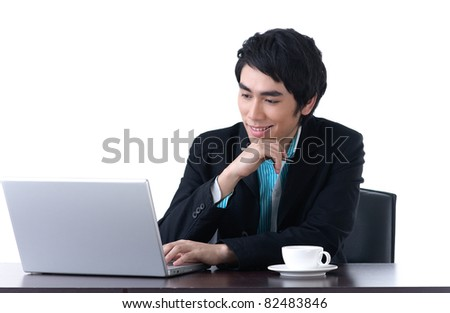 A happy young business man working with laptop - stock photo