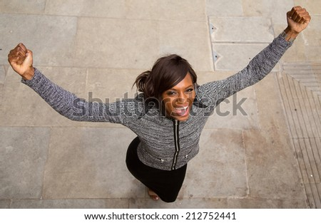 A happy young business woman - stock photo